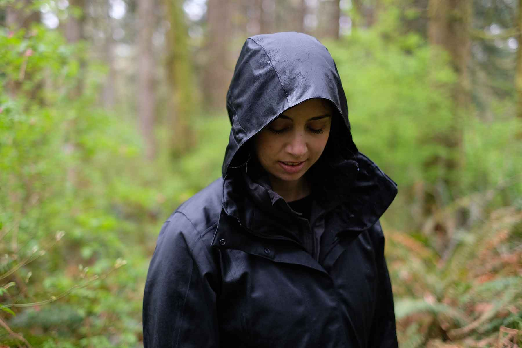 Woman wearing rain jacket in nature