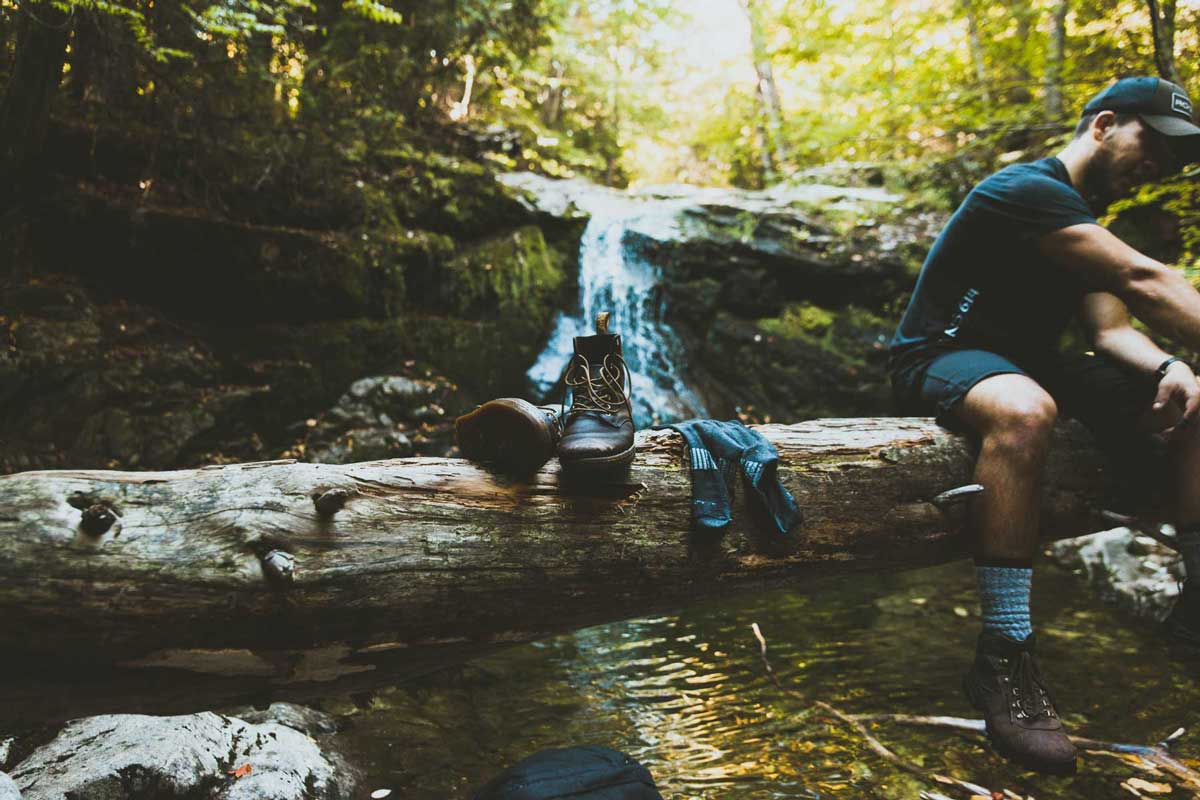 Adventurer washing his socks in nature