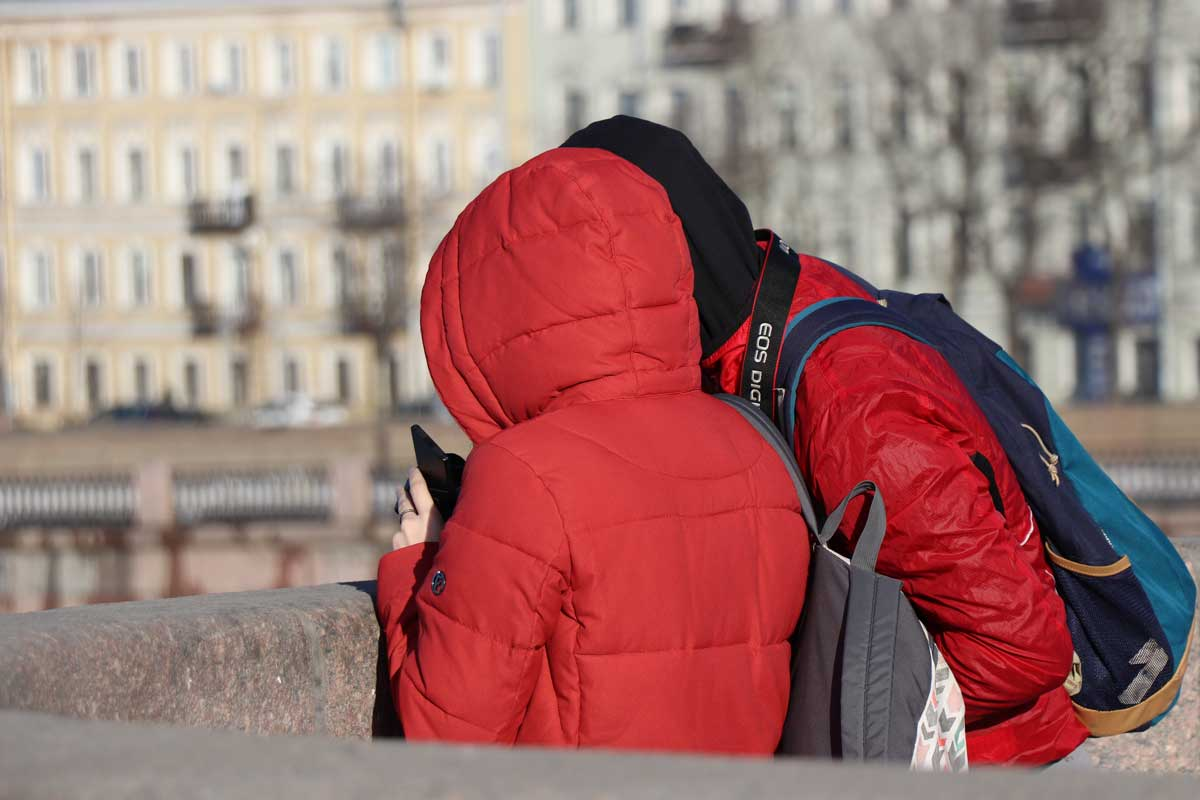 Couple wearing insulated jackets