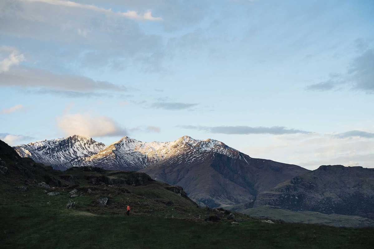 Hiker with altitude sickness near snow capped mountain