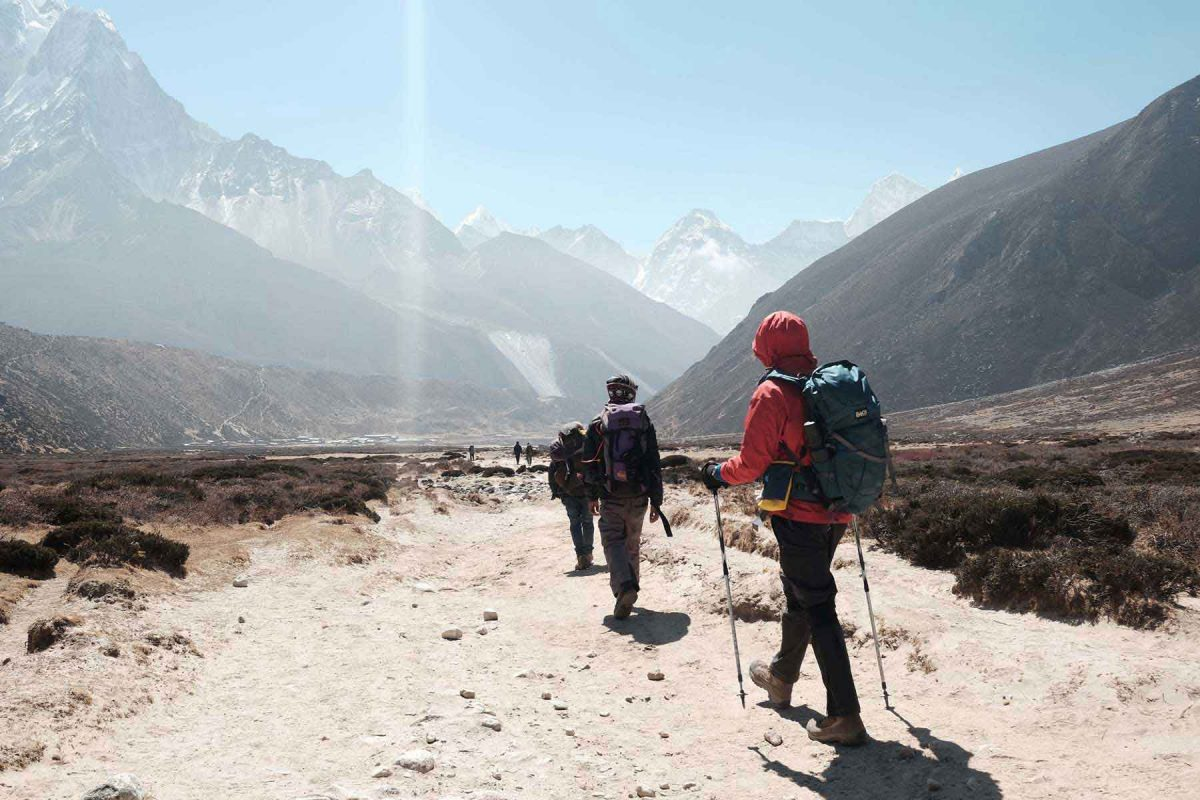 Backpackers walking with trekking poles