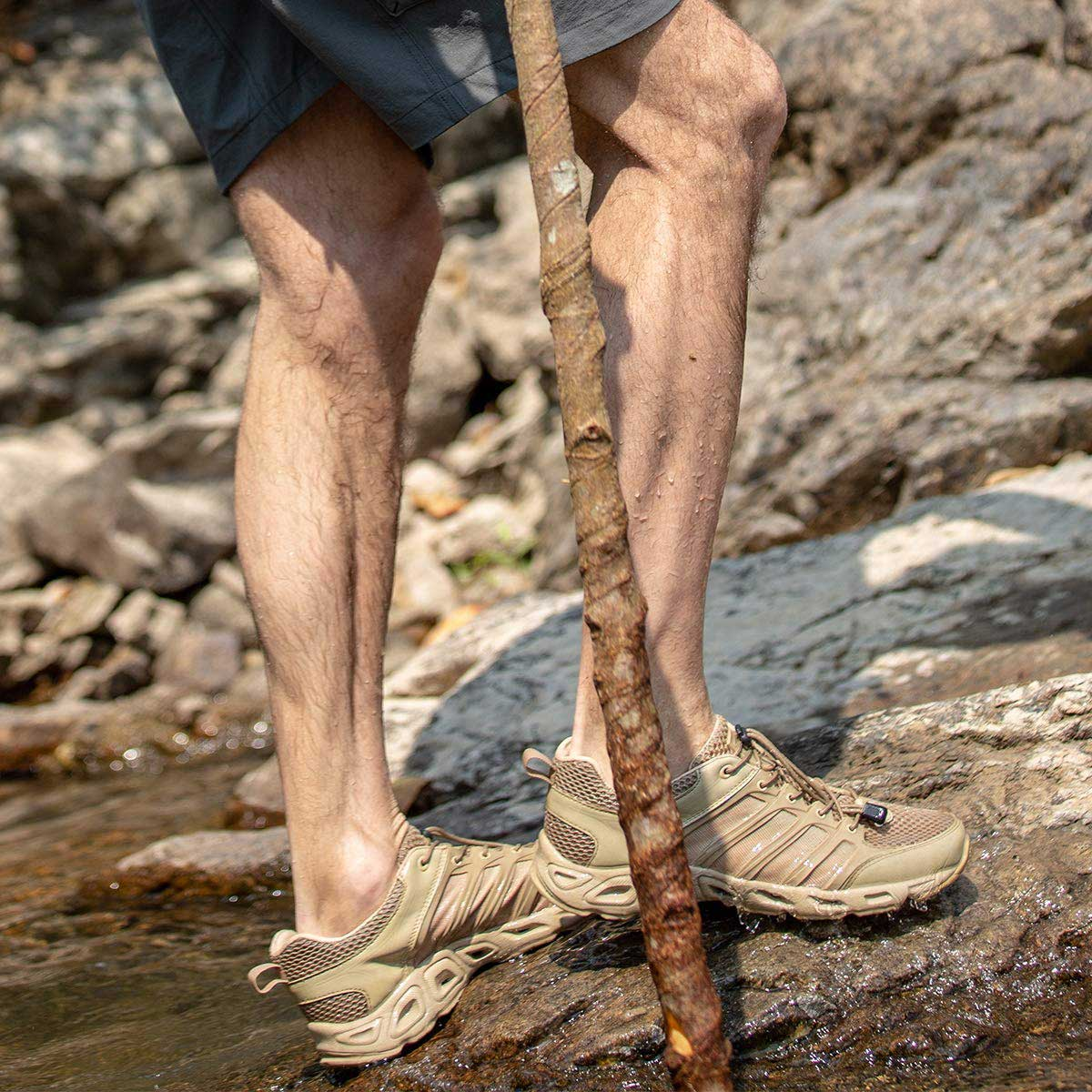 Man wearing tactical shoes is crossing a stream