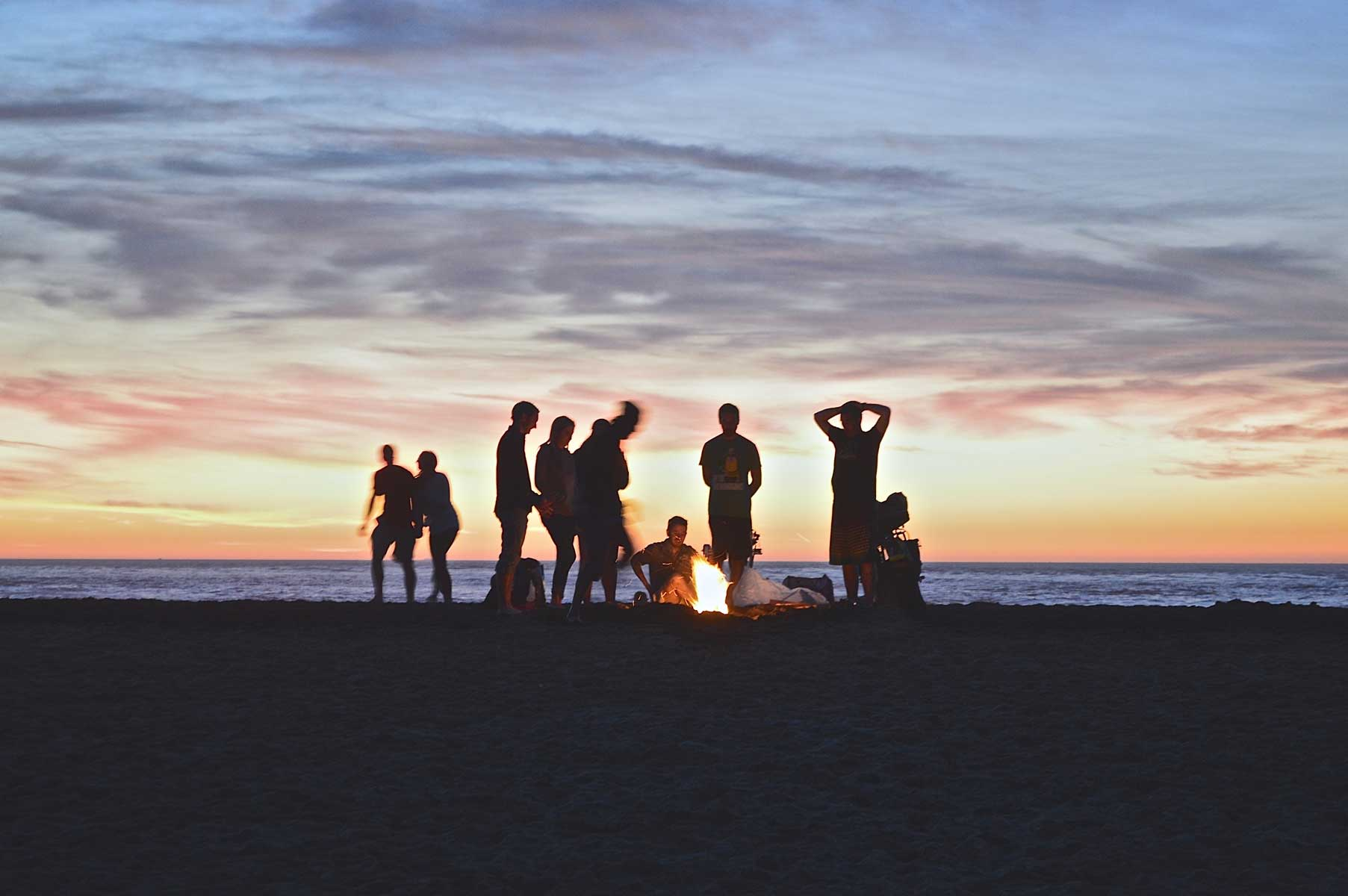 Hikers around campfire in the evening
