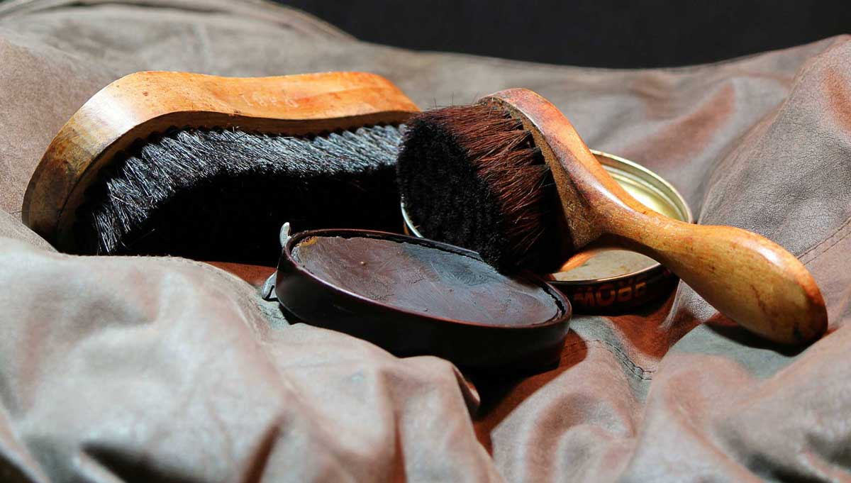 Shoe shine tools and black polish