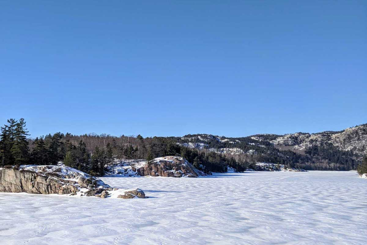 Winter hiking: frozen lake covered in snow