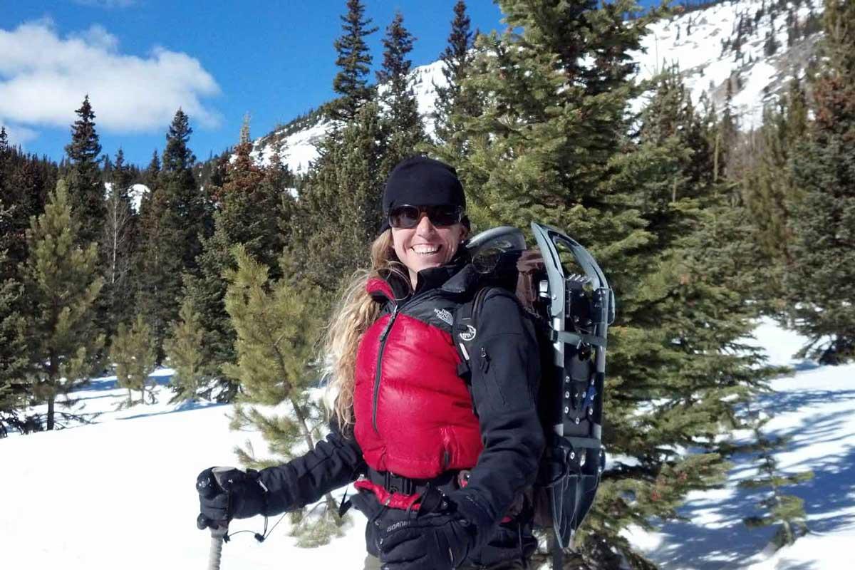 Woman hiker in winter jacket