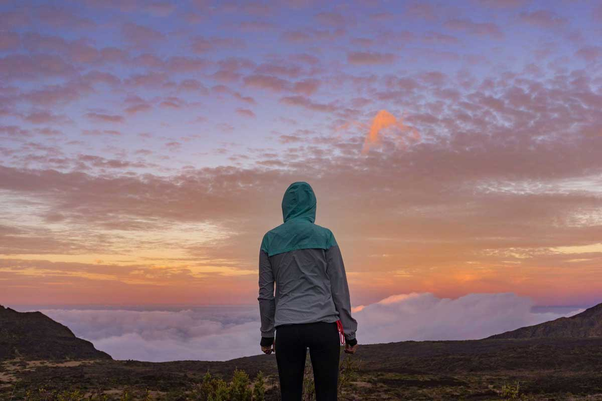 Woman standing on a mountain looking ahead