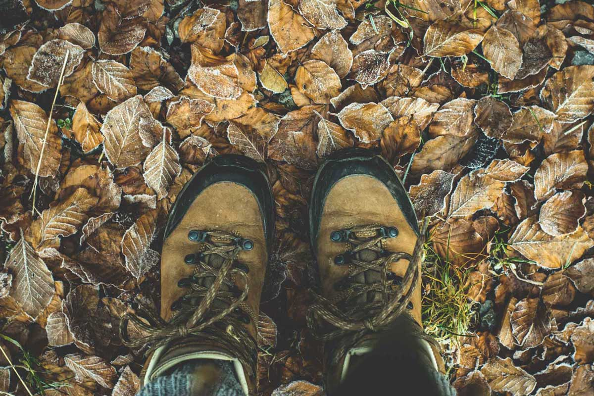 Hiking boots with leather uppers outside in autumn