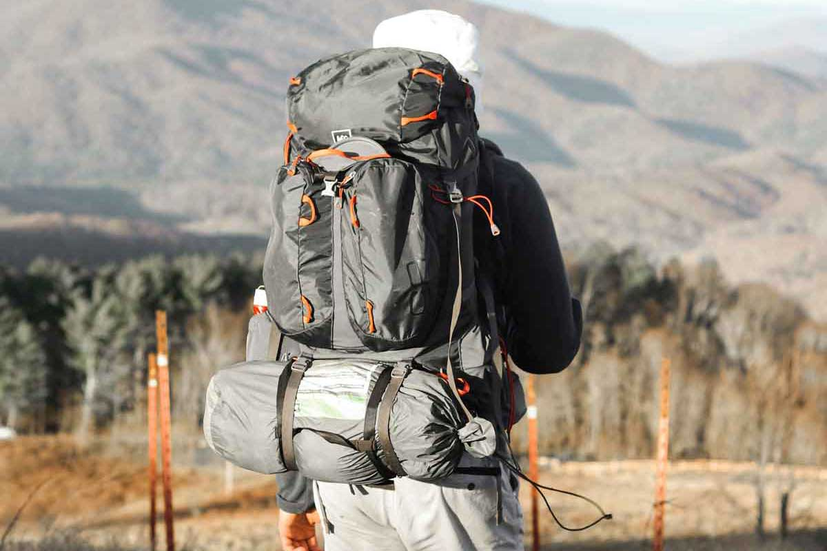 Backpacker wearing well-packed hiking backpack