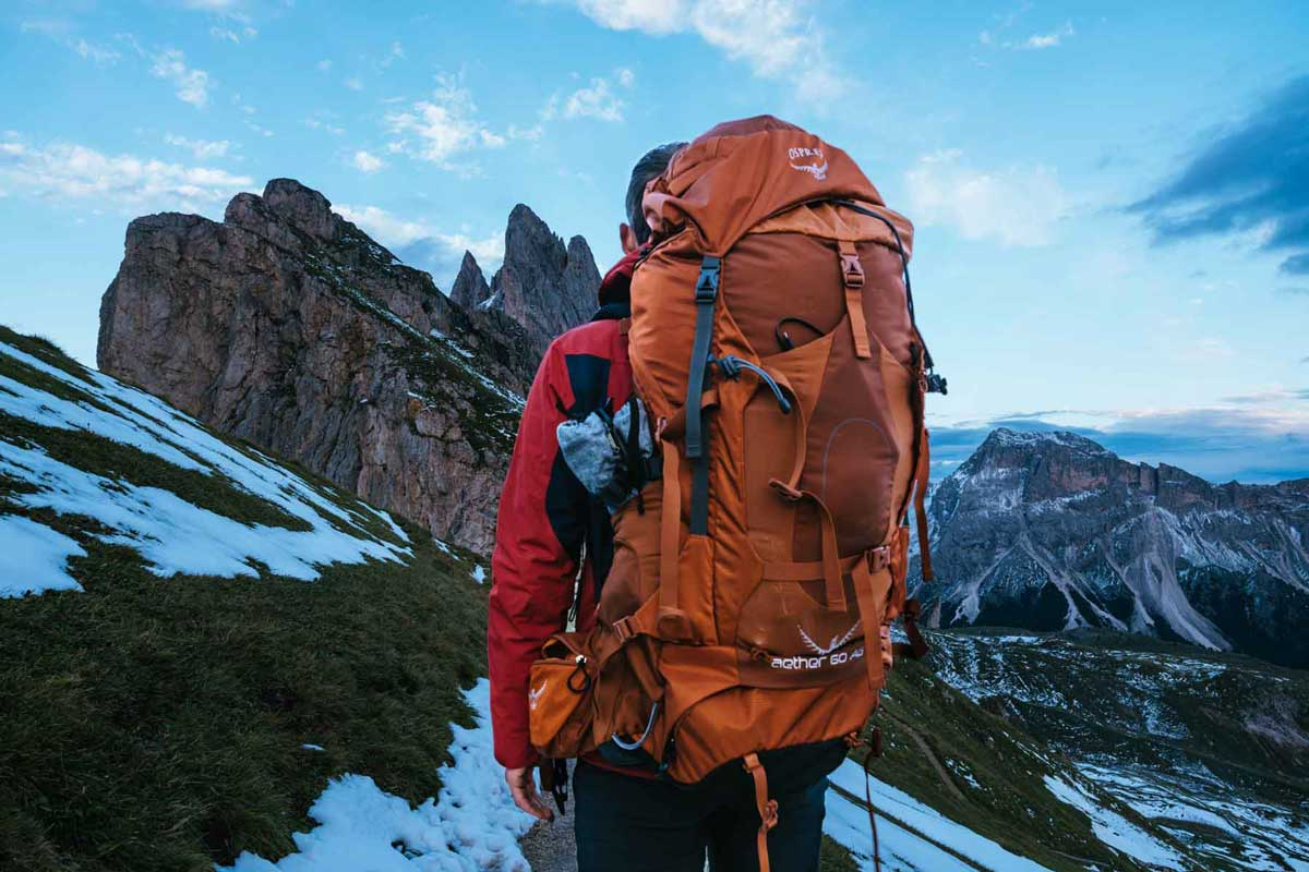 Backpacker wearing a large internal frame pack