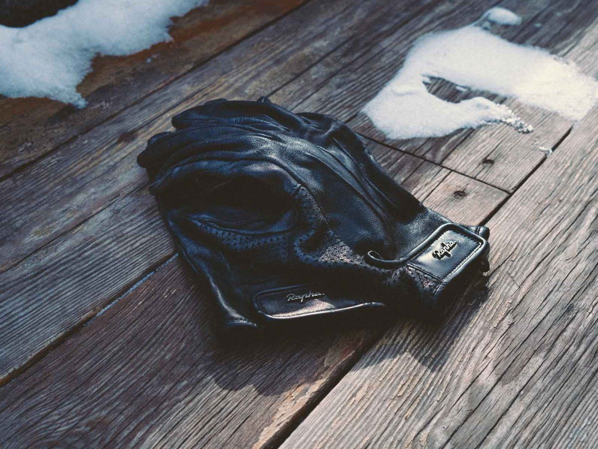 A pair of leather gloves on a wooden table