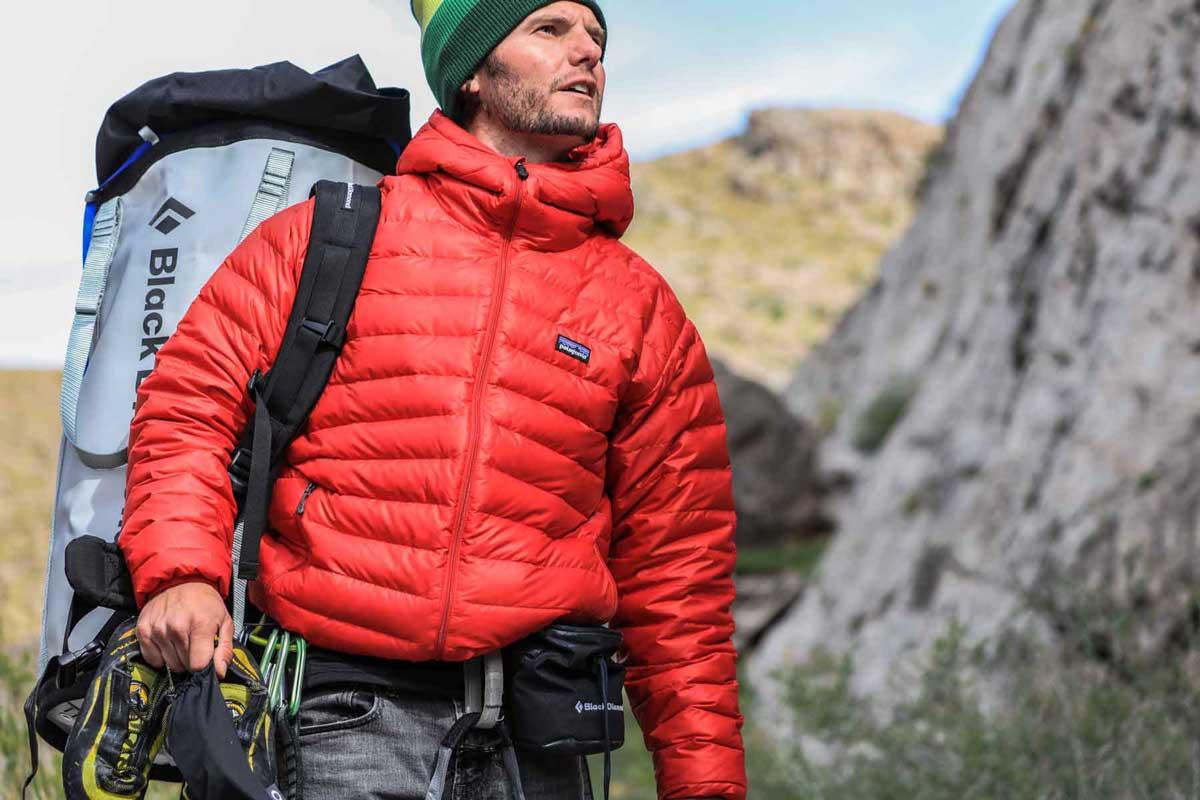 Climber wearing rain jacket