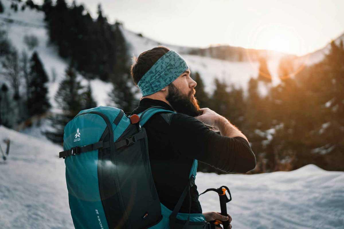Backpacker wearing multifunctional neck gaiter