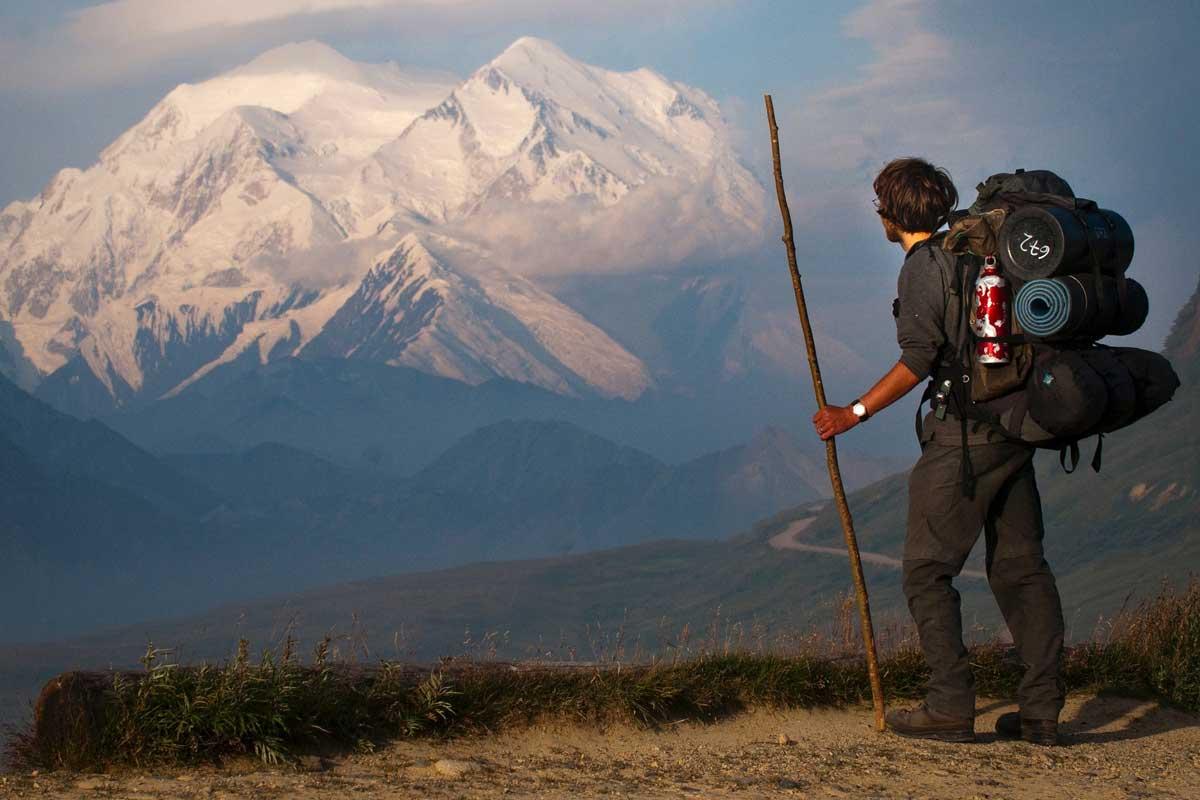 Man hiking alone near mountain