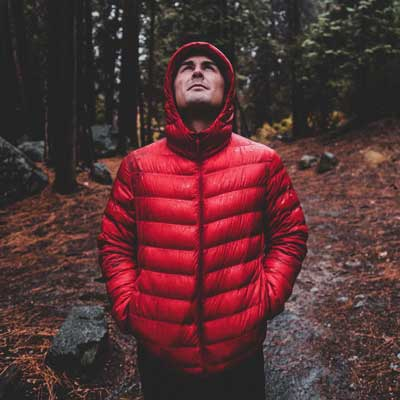 Hiker wearing waterproof breathable jacket