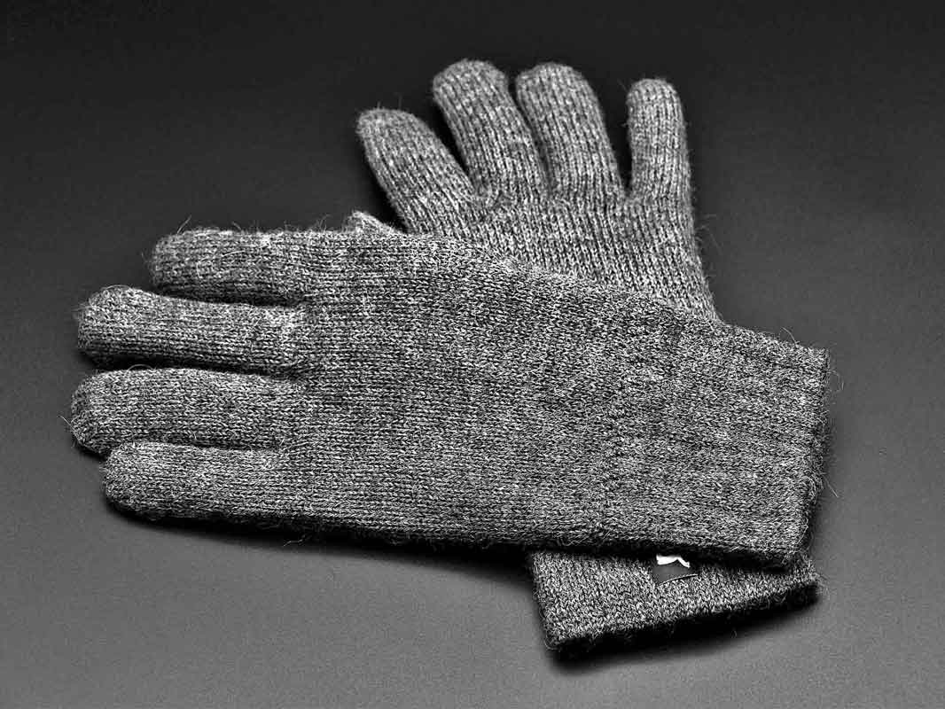A pair of liner gloves made of wool