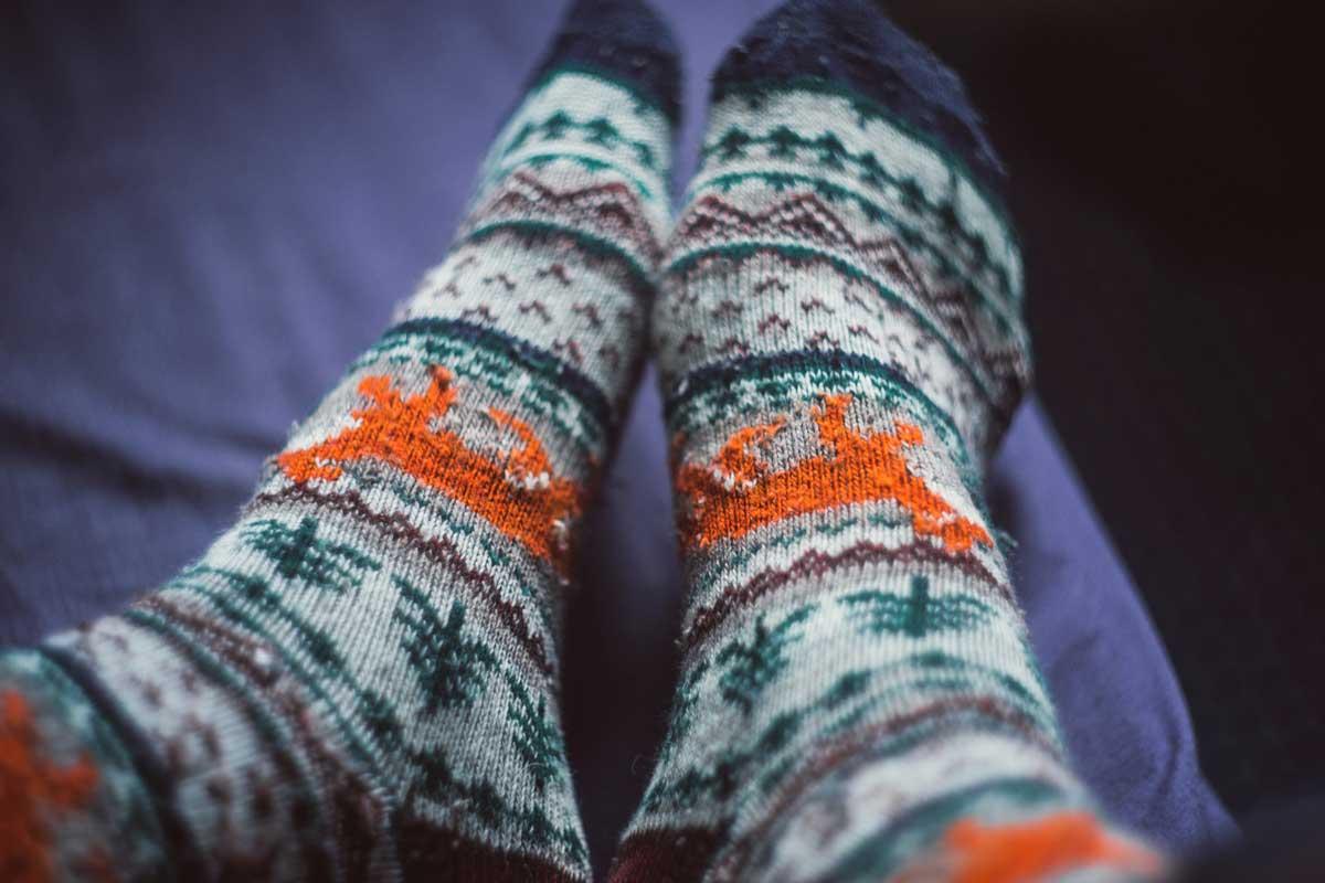 Feet wearing winter socks