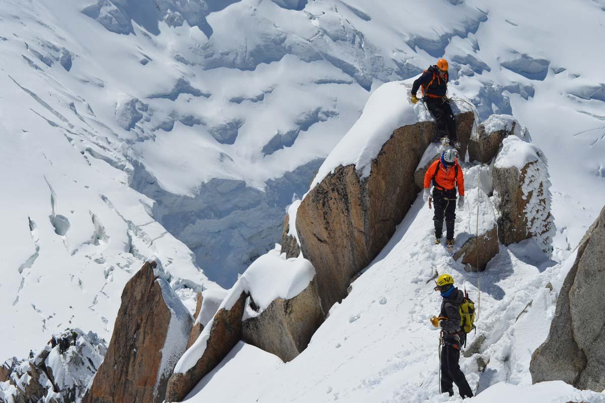 Mountaineers wearing hardshells in the mountain