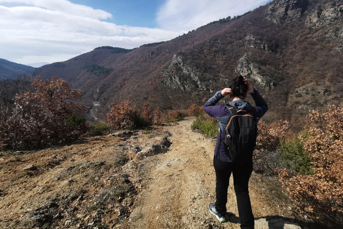 Hiker woman backpack mountain